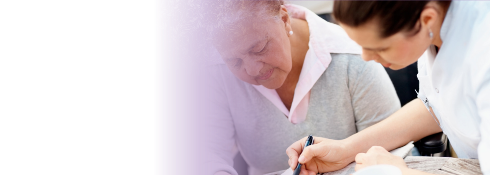 the caregiver accompanied the elderly woman on writing