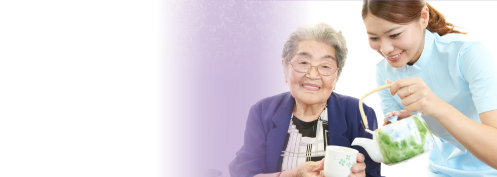 the elderly woman with the caregiver showing a happy face